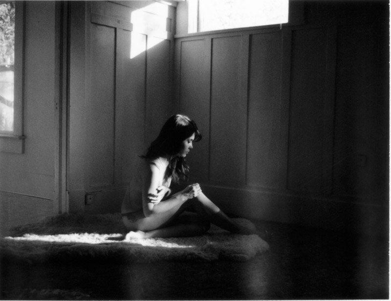Boudoir photograph of model in abandoned home using polaroid film.