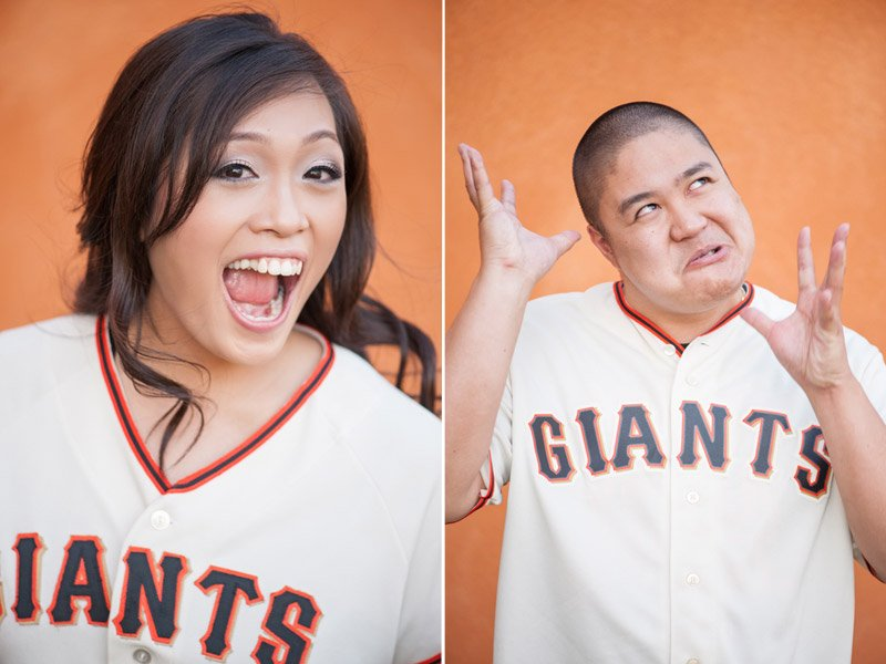 Engaged couple making silly faces while wearing giants uniforms