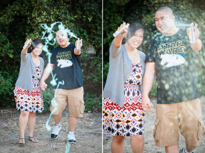 Couple spraying silly string at camera during engagement session