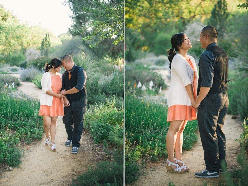 Engaged couple walking through UC Davis Arboretum