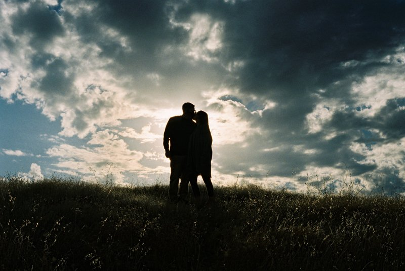 35mm photo of couple against cloudy sky