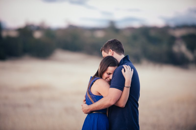 Loving embrace of just engaged couple