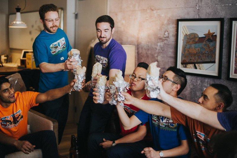 Groom and groomsmen with El Farolito burritos