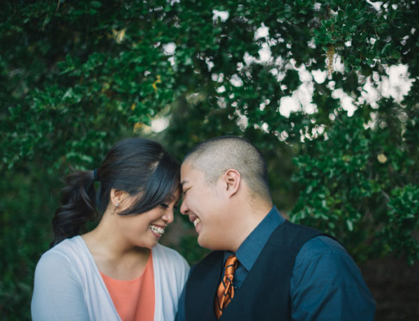 candid engagement image of couple smiling